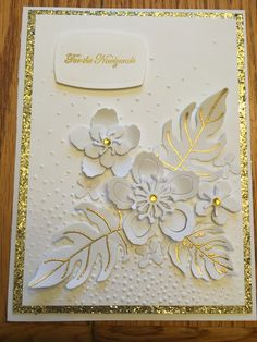 Use Flower shop and Petit Flowers stamped amd punched on white and white embossed. Dye cut a few leaves in white and trqace veins in gold pen. Design as is