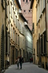 Lucca -- If you follow this path, there should be a wonderful pizza place.