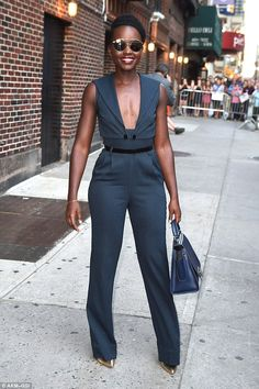 Stunning: Lupita Nyong'o showed exactly why she is the darling of the  fashion world, as she showed off her impressive sartorial style in a plunging catsuit on Friday in NYC