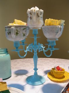 Teacup Candleabra! Found candleabra at tag sale, spray painted aqua; found teacups at thrift stores and used epoxy to attach to each candle holder. Fill with sugar cubes, sweetener packets & honey!