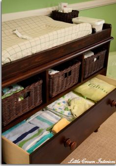 Dresser with changing table on top. Take first drawer out and put baskets in to keep items  (lotions, powder, diapers etc.)