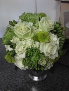 Bridal bouquet of white and green roses, white hydrangea  w/ green spider mums, and green hypericum berries