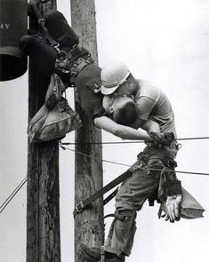 """""""The Kiss of Life"""" photograph by Rocco Morabito, 1967. Utility worker J.D. Thompson gives mouth-to-mouth to co-worker Randall G. Champion after he went unconscious following contact with a low voltage line."""