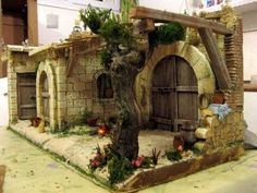crib making for christmas Fontanini Nativity, Diy Nativity, Christmas Nativity Scene, Christmas Villages, Hobbit Door, Arched Doors, Ceramic Houses, Stone Houses, Inspired Homes