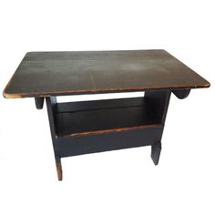 19thc Original Black Painted Lift Top Table From Pennsylvania   USA   1850-1860   FANTASTIC ORIGINAL SURFACE 19THC LIFT TOP TABLE WITH ORIGINAL FIRST PAINT SURFACE. THIS TABLE HAS A GREAT ORIGINAL ALIGATORED SURFACE. WONDERFUL BOOTJACK FEET WITH GREAT CUT OUTS.THE LIFT TOP INSET DOOR HAS BREAD BOARD ENDS.THIS TABLE CAME FROM A COLLECTION IN PENNSYLVANIA.THE ENTIRE CONSTRUCTION IS SQUARE NAILED AND WOOD PEGS .THE FORM AND CONDITION IS THE VERY BEST.