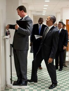 """Obama lol - """"We were walking through a locker room at the University of Texas when White House Trip Director Marvin Nicholson stopped to weigh himself on a scale. Unbeknownst to him, the President was stepping on the back of the scale, as Marvin continued to slide the scale lever. Everyone but Marvin was in on the joke."""" (Official White House Photo by Pete Souza)"""
