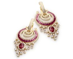 These earings are cool n different.Gift a traditional set of earrings with a Kanjeevaram sari.