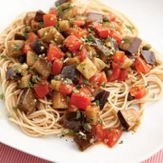 Try this healthy recipe for Eggplant Pomodoro Pasta. Diced eggplant turns tender and tasty sautéed with garlic and olive oil. Toss with fresh plum tomatoes, green olives and capers and you have a simple light summer sauce. We like it over angel hair pasta, but any type of pasta will work. Serve with freshly grated Parmesan cheese and a mixed green salad. @EatingWell