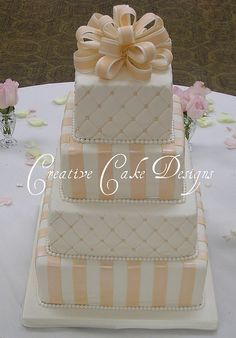 Square Wedding cake by Creative Cake Designs (Christina). Love this cake, not so much the color