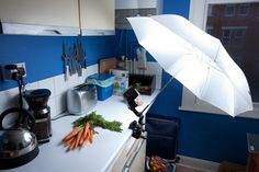 https://flic.kr/p/5Wo4aR | Carrots lighting setup | This is what happens when I'm left alone for a weekend. Yet again I'm photographing objects from my kitchen to practice photo technique. This time it's bouncing light with an umbrella on a clamp.