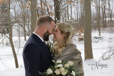 we loved the antique shawl and shades of cream in the bouquet. Perfect for a winter wedding elopement at The Little Log Wedding Chapel in Niagara
