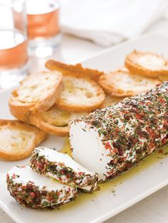 4 Easy, Make-Ahead Appetizers That'll Wow Your Guests America's Test Kitchen Goat Cheese with Pink Peppercorns and Herbs
