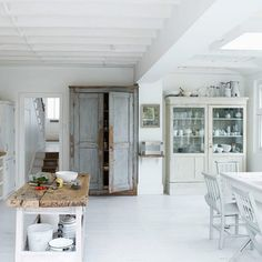 I love this weathered look - I really love the glass front cabinet