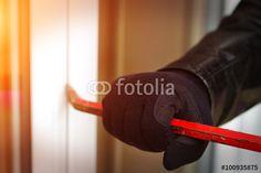 """Laden Sie das lizenzfreie Foto """"Burglar breaking in a house"""" von sdecoret zum günstigen Preis auf Fotolia.com herunter. Stöbern Sie in unserer Bilddatenbank und finden Sie schnell das perfekte Stockfoto für Ihr Marketing-Projekt!"""