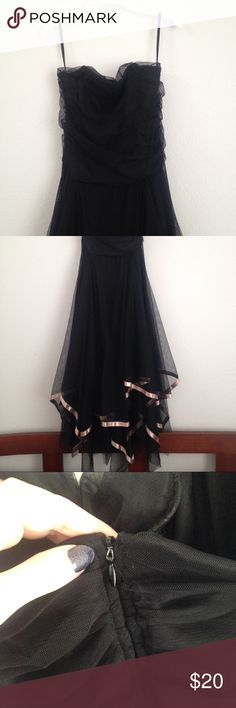 Elegant Black Strapless Dress Elegant long black dress. Ruched bodice with boning to help it keep its shape. Zipper in back. Beautiful multi-layer skirt lined with pale pink ribbon. Bought at a thrift store a few years ago and only wore it once to a dance. One small spot on the skirt, it looks easy to remove.  All items come from a smoke-free, pet friendly home. No trades, no PayPal please. Any questions, comment below and I will answer to the best of my knowledge. Happy Poshing! Better Be…