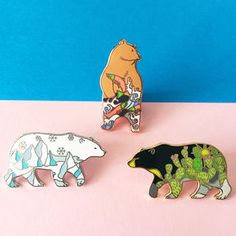 More beautiful pins from our favourite gal Natelle Draws StuffBlack Bear with cactus designWhite Bear with snow and icebergsBrown Bear in standing position with river and jumping salmonHard enamel, 32mm, rubber clutches