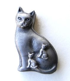 Moonflygirl: Boot Sale Finds of the Day - Files and a Torino Pewter Cat  Torino Cat Trinket Box with Brooch lid and Kitten Stud Earrings   - I found that they were made by Torino, and there are lots of designs in that series - many of which are very cute,such as an owl, cow..   is my cat - it seems like it's missing a chain and small pendant    The top tool is actually a saw, with the blade nested inside the handle. Quite cool!