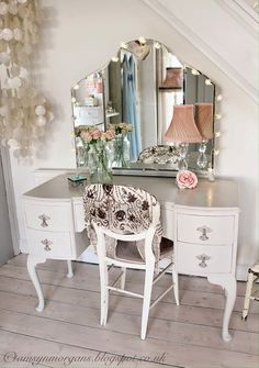 paint mya's dressing table white and give it pink accents