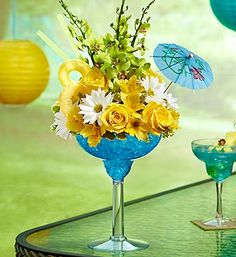 A tropical treat for the senses -- that's our truly original Happy Hour bouquet, inspired by the popular Hawaiian cocktail. Our expert florists hand-arrange the freshest roses, Dendrobium orchids, alstroemeria, daisy poms and solidago in an oversized margarita glass, topped with a faux pineapple pick, straws and a paper umbrella to make any celebration an exotic affair. All they'll need is a hula skirt.
