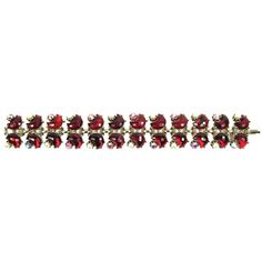"""1950  Featured is a stunning vintage 1950 bracelet. It has glass red crescent shaped stones and alternating sparkling Aurora Borealis and faux pearl stones. It is a nice wide 1"""" bracelet. The clasp is strong."""