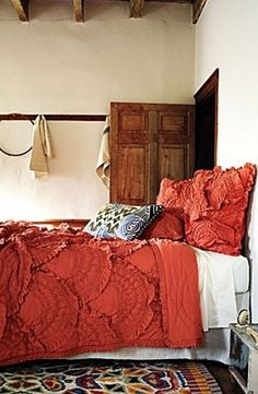 Love it all, especially the texture of the bedding.
