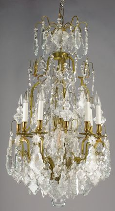 A FRENCH CUT CRYSTAL EIGHT-LIGHT CHANDELIER AND PAIR OF SCONCES.Early 20th Century.