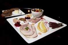 At backbar, operated by the people who run adjacent restaurant Journeyman, choose-your-own charcuterie platters are among the offerings. The menu changes daily, written in chalk upon the walls.
