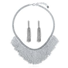 This 2-piece statement jewelry set brings an edge to polished layers of chains for a dramatic look. Made of silver-tone brass. Necklace measures 18 inch with 2 inch extension in length with 2 inch in drop and secures with lobster claw clasp. Earrings measure 3 inch in length, 0.75 inch in width. Edge posts with butterfly back closures.