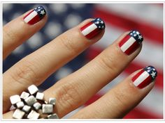 patriotic. I saw this and wondered how to do the stars, and then thought of just doing alternating star nails and stripe nails. You could get small star stickers and just take the stickers off and have the shape left there.