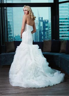 the back of the mermaid gown with a sweep train