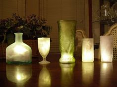 there is spray paint you cn buy to make regular glass look frosted. then light it up from inside!