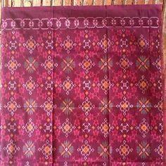 kain tenun ikat motif tali ulang bali warna merah tua