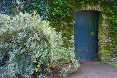 Secret Garden blue door and stone doorway