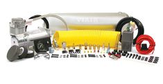 """(1) 2.5 Gallon Viair Air Tank  (1) 400C model Viair Air Compressor  (1) 35ft. Coil Hose  (1) 1/4"""" Quick Connect Stud (F)  (1) 1/4"""" NPT Quick Connect Coupler (F)  (1) Dash Panel Gauge with ON/OFF Switch (1) Pressure Switch with Relay (110 PSI on, 150 PSI off)  (1) Reducer (1/8"""" NPT F to 1/4"""" NPT M)  (1) 1/4"""" NPT 175 PSI Safety Valve  (1) 1/4"""" Drain Cock  (3) 1/4"""" NPT Compression Fittings  (1) 4-inch Strip of Continuous Grommet Material  (1) 20ft. 12 Gauge Wire with Inline Fuse Holder"""
