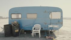 Rickety Old Vintage Abandoned Caravan/trailer In A Deserted Camp/area.An Old Rusty Caravan Near A Pier Close To An Abandoned Industrial Camp. Stockfootage en -video's 12135623 - Shutterstock