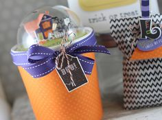 2015  first treat is a little Pint Container decorated with the Pint Size Wrap die in an orange polka dot paper.  I added in Petite Places: Spook Manor under a Clear Dome.  I made in a tag made from Haunted Headstones to the top of the pint container with some twine from the Make it Market: Halloween Pin Up kit and some Royal Velvet Saddle Stitch Ribbon.