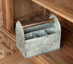 This farmhouse tool caddy is great for the garden, home or office. A galvanized tin caddy holds everything from spades and gloves to pens and scissors. Metal dividers offer structure and endearing cha