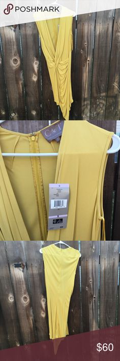 """Costello & Tagliapietra dress Spring 2014 runway Designer dress straight off the runway, sort of a wrap style with slinky curves and low cut neckline. Zipper back. Mustard yellow color called """"sprout"""". From spring 2014 collection. Brand new with tags! Costello & Tagliapietra Dresses"""