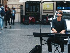 Handsome man tranquil playing the piano in the streets of Rome (April 2016)
