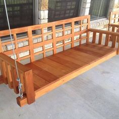 """This solid mahogany porch swing has a very appealing design with intricate lattice work accenting the back. The Fijian mahogany's beautiful finish is created using teak oil which also acts as a protective finish against the elements. This porch swing is designed to be supported by galvanized steel cable, and is sure to last a lifetime! Premium German-made hanging hardware and galvanized steel cable is INCLUDED! This porch swing measures 78"""" L x 25"""" D x 24"""" H. Also available..."""