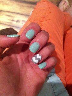 Blue nail polish with gray and white chevron design