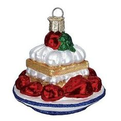 Strawberry Shortcake Christmas Ornament 32178Merck Family's Old World Christmas **New for 2012** Strawberries have been enjoyed as a delicacy for centuries, and shortcakes