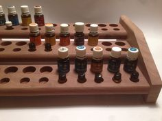 This Handmade Essential Oil Rack is made of Walnut Oak Cedar or Pine and designed to sit on your dresser, counter, or shelf. It is designed to hold 30 (15ml) bottles and 30 (tester bottles). It measures 4 1/2 tall, 10 1/2 deep, and 17 wide. The item in the picture is Natural Walnut with No Laquer Applied.This is a great way to store your oils and or display them. These make great gifts for any oil user and will help organize counter space and de-clutter. Also keep in mind we can add any size…