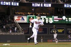 Minnesota Twins' Josh Willingham heads to home plate after hitting a three-run home run against Oakland Athletics pitcher Brian Fuentes during the ninth inning to win the baseball game 3-2, Tuesday, May 29, 2012