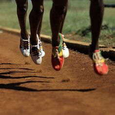 The synchronized feet of 3 Olympic runners...
