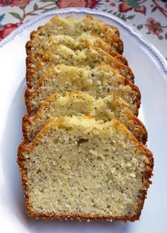 Almond Poppy Seed Bread Recipe ~ Says: the glaze on the bread is amazing but the bread is not one I will repeat. I would use the glaze on a different poppy seed bread recipe. Köstliche Desserts, Delicious Desserts, Dessert Recipes, Yummy Food, Almond Poppy Seed Bread, Almond Bread, Poppy Seed Bread With Glaze, Almond Milk, Coconut Milk