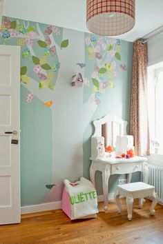 Someone more crafty than I - what do you think the leaves are made of? Can you modge podge scrapbook paper on a wall? I've always wanted a tree in one room of our house.