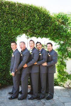 charcoal groom look with hint of yellow http://www.weddingchicks.com/2014/02/06/thursday-club-wedding-yellow-inspiration/