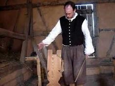 An Interpreter at the 1710's German Palatinate Farm at the Frontier Culture Museum demonstrates how to obtain flax fibers from the flax plant. -ss