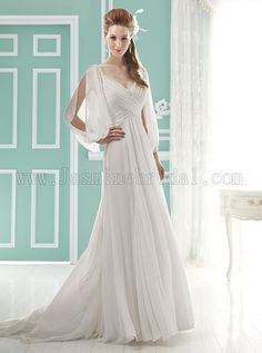 Love the split sleeve detail on this gown and the criss cross draping in front